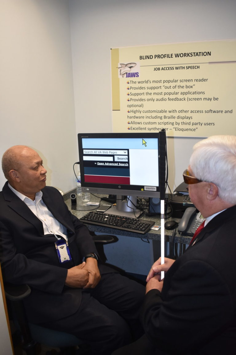 Care Review Partnership - 2 Men Sitting at a Desk reviewing